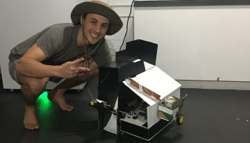 "Alexandre Kneifel with his robot-in-progress ""Shake n Bake"""